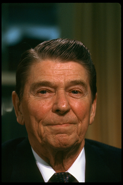 Closeup portrait of President Ronald Reagan sitting at desk in the Oval Office of the White House after adressing the nation, re Iran-Contra affair.  (Photo by Diana Walker//Time Life Pictures/Getty Images)